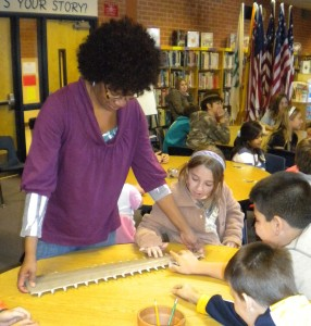 Mrs. Miller sharing our sawfish rostrum with students!