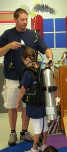 greg-helping-student-with-scuba-gear-cropped