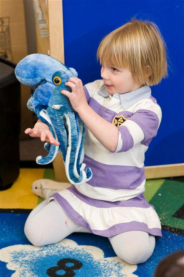 little girl with stuffed octo.jpg