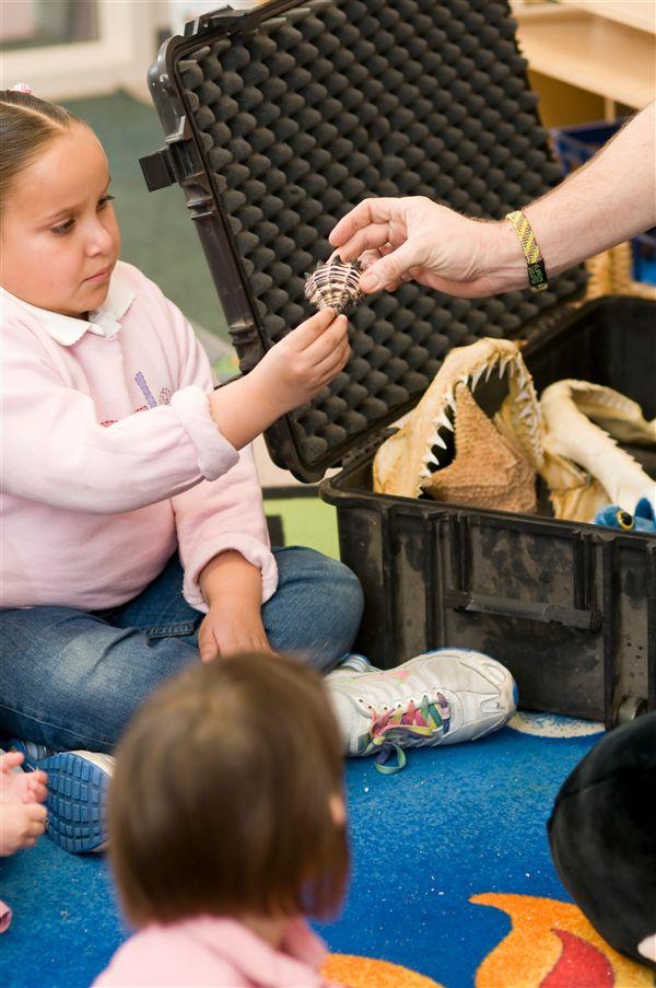 preschooler with artifacts.jpg